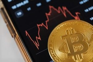 Bitcoin and a phone sreen